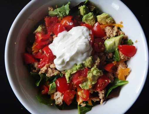 Taco salald with ground turkey, avocado, tomato, greek yogurt over spring mix
