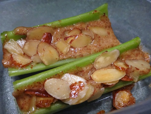 Celery stick with almond butter and honey almonds