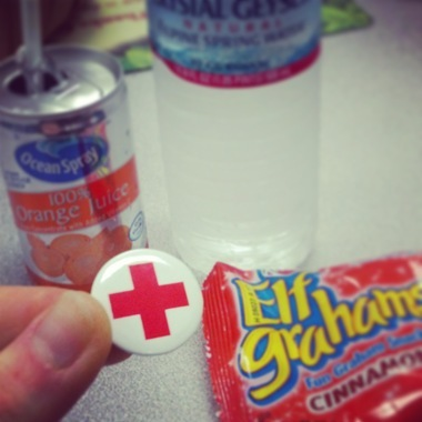 Blood donor pin and snacks from the red cross