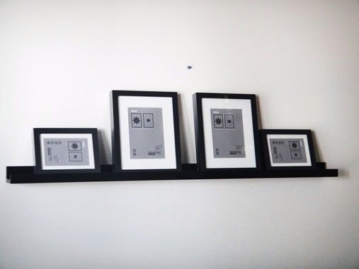 Over the couch photo ledge and frames from Ikea