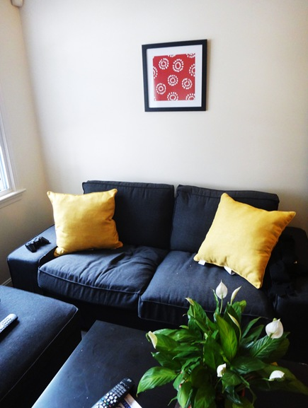 Red framed print over couch