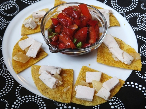 balsamic tomatoes and basil with chicken and parmesan on tortillas caprese nachos