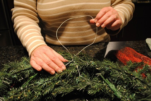 Mom making DIY Christmas Wreath