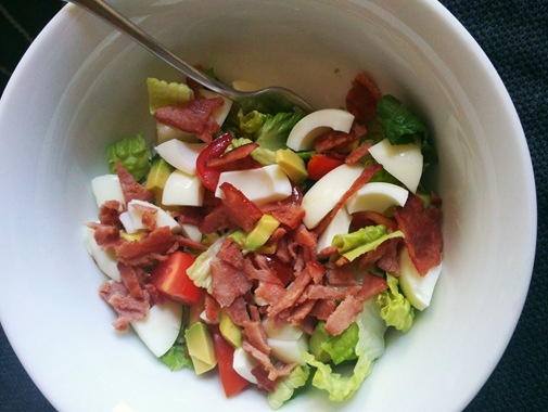Cobb salad with romaine hardboiled egg turkey bacon avocado and tomato