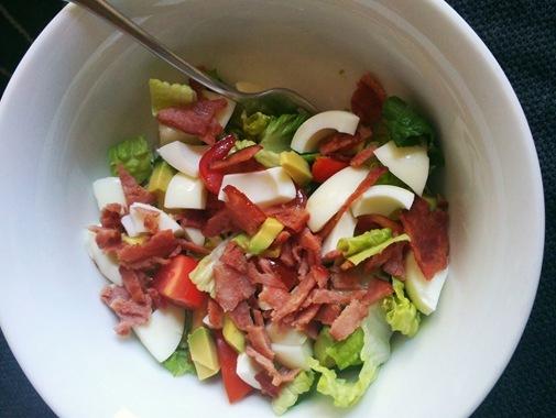 Cobb salad with romaine hardboiled egg turkey bacon avocado and tomato