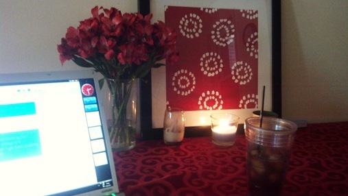Trader Joe's flowers on the table next to computer