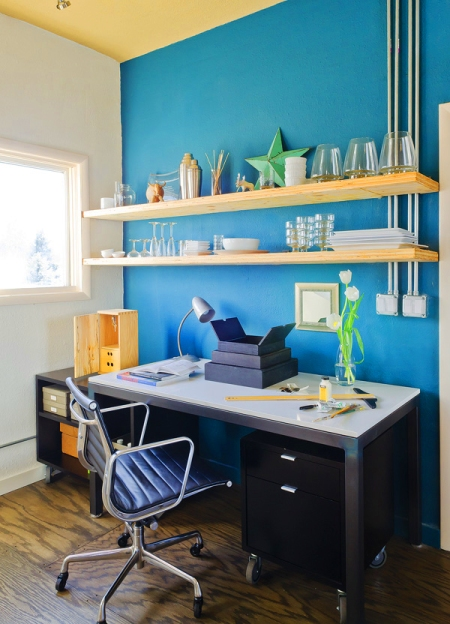 Above desk wall shelves via Mix And Chic
