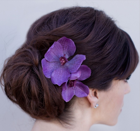 Tropical wedding hair with flowers