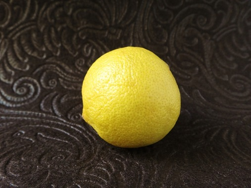 Lemon on brown felt