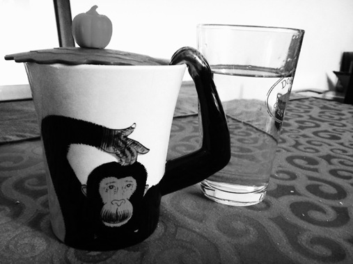 Monkey mug with coffee and coffee topper