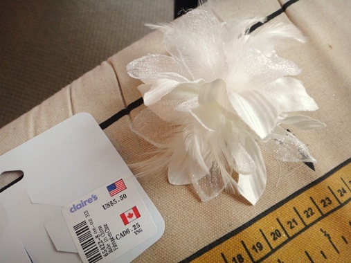 wedding dress flower pin with feathers from Claire's