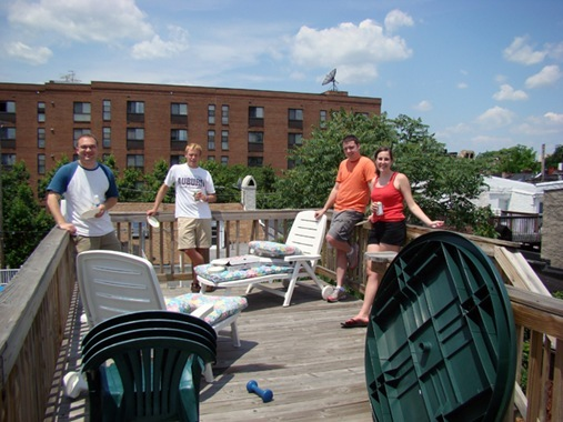 Friends on roofdeck in Fells Point on moving day