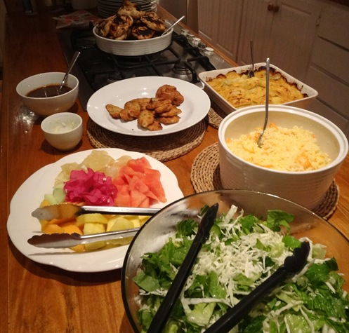 St. Lucian welcome BBQ dinner: grilled chicken, salad, rice, fresh fruit