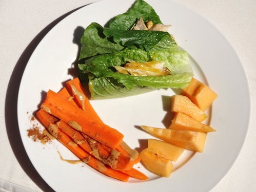 Low FODMAP travel meal- plain chicken on lettuce wrap carrots with nut butter melon