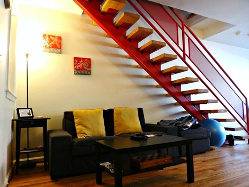Couch under stairs