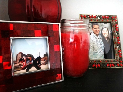 K's dresser with red picture frames and red candle