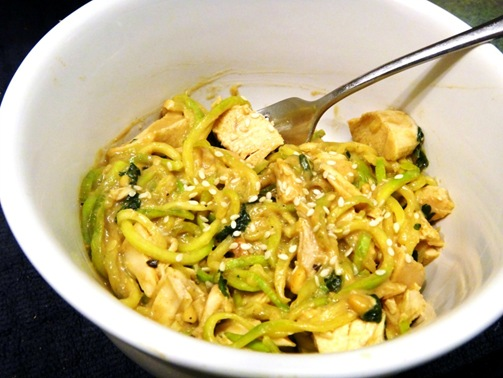 Spiralized zucchini noodles with homemade peanut sauce, chicken, cilantro, sesame seeds and lime