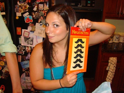 Jenna with stick on fake moustaches