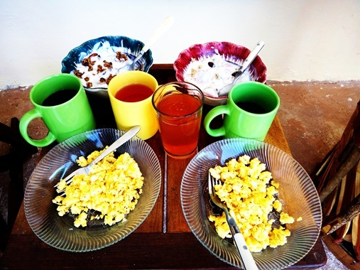Scrambled egg breakfast with yogurt bowls