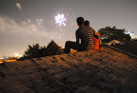K and Z watching fireworks from roof in Fells Point, Balimore, MD
